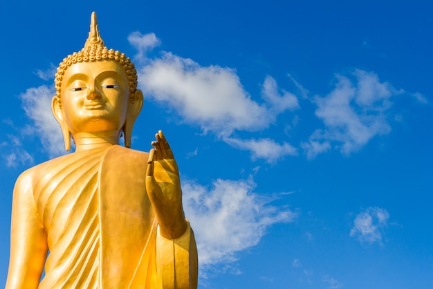 Golden buddha  on the sky background