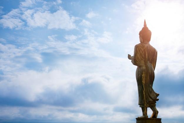 Golden buddha statue standing at wat phra that khao noi, nan province, thailand