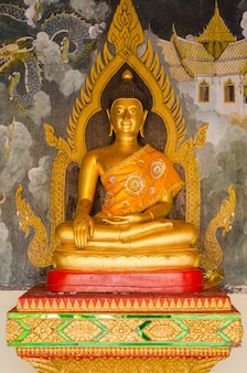 Golden buddha statues in front view