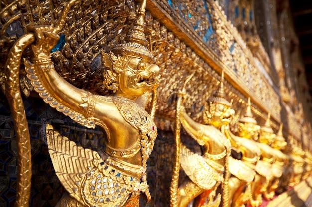 Golden buddhist statue in bangkok,thailand