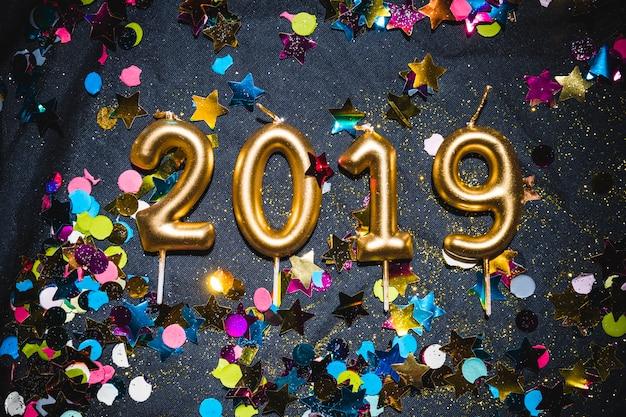 Golden candles 2019 on festive floor
