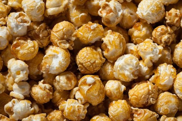 Golden caramel popcorn closeup.