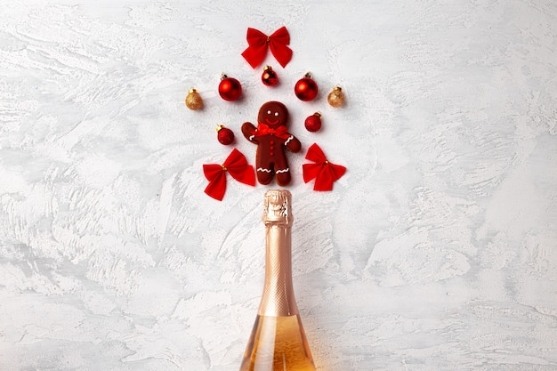 Golden champagne bottle with christmas gingerbread flatlay top view