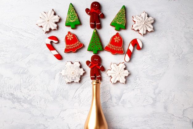Golden champagne bottle with christmas gingerbread flatlay