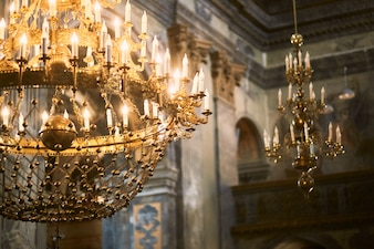 Golden chandelier hangs from the ceiling in church