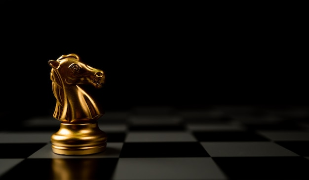 Golden chess horse standing alone on the chessboard
