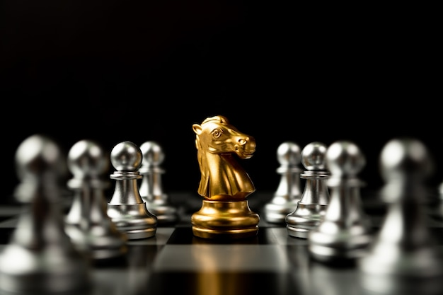 Golden chess horse standing to be around of other chess