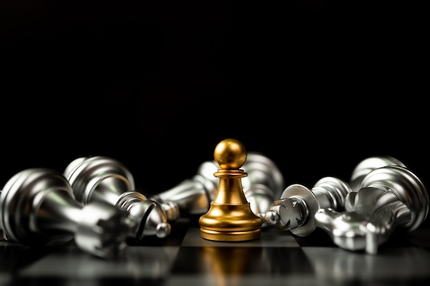 Golden chess pawn is last standing in the chess board
