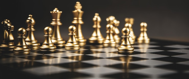 The golden chess standing in front of team.