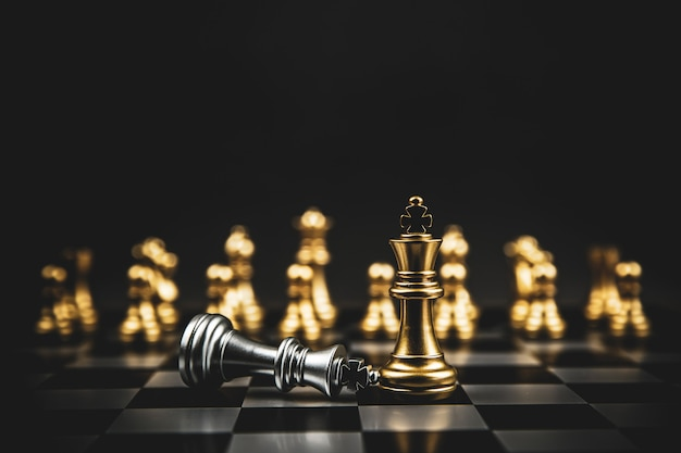 Golden chess team standing on chess board.