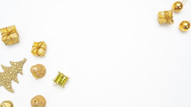 Golden christmas accessories on white background top view copy space