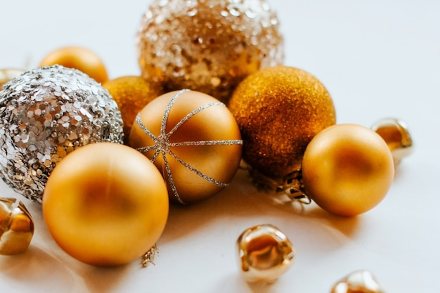 Golden christmas balls with sparkles.