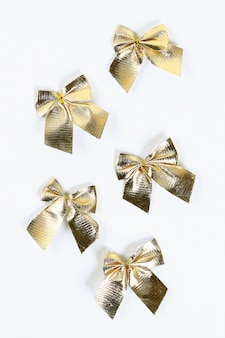 Golden christmas bow on a white background.