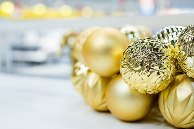 Golden christmas ornaments at market store