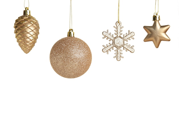 Golden christmas toys isolated on white background. top view