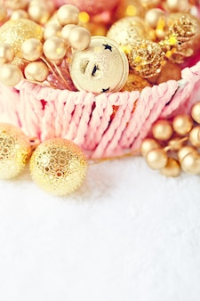 Golden christmas toys on a light background.