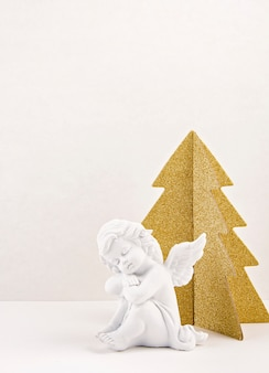 Golden christmas  tree and white angel.