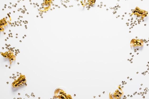 Golden circular confetti frame top view