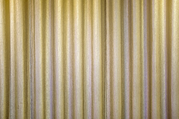 Golden closed curtain with light spot on the stage
