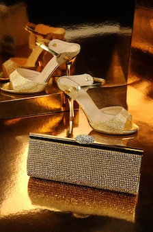 Golden clutch inlaid with rhinestone and a pair of gold shoes