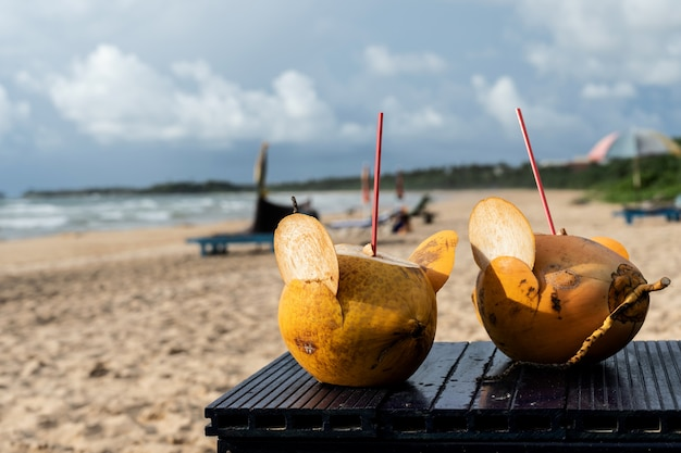 Golden coconut cocktails on the beach