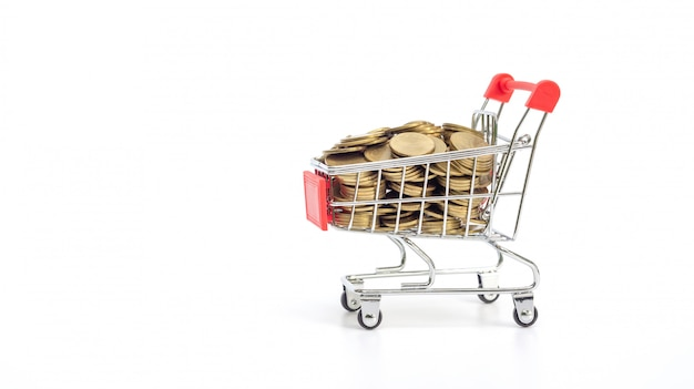 Golden coin in a shopping cart on white