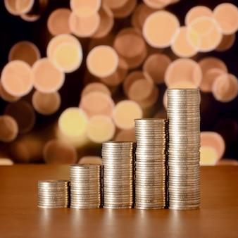 Golden coin stacks arranged as a graph. increasing columns of coins