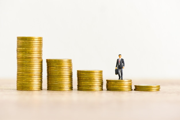 Golden coins stack on wooden table background, stack of coins financial growth ladder and business