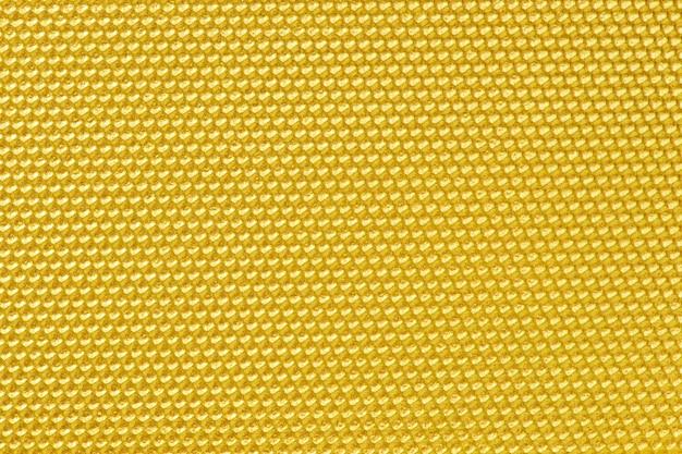 Carta da parati a nido d'ape color oro
