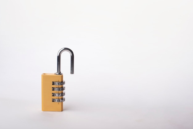 Golden combination lock isolated on white background