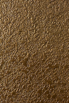 Golden concrete wall with soft light coming in from the left for design work 3d illustration