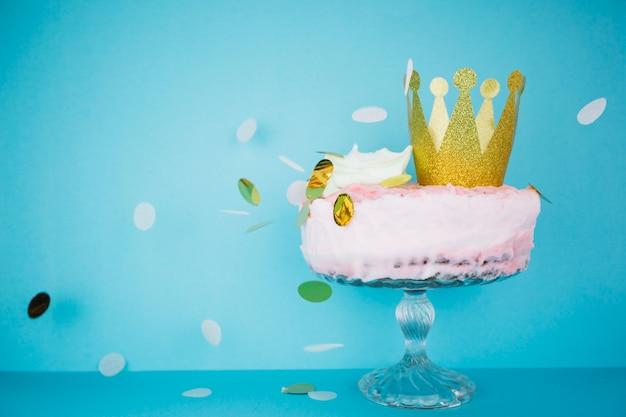 Golden confetti falling on cute cake