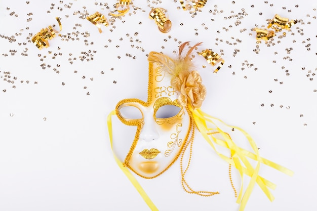 Golden confetti frame and golden mask
