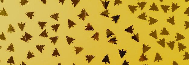Golden confetti glitter on illuminating color pastel festive