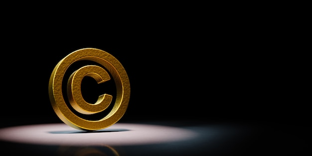 Golden copyright symbol spotlighted on black background