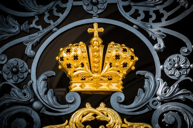 The golden crown of the russian empire with antique metal forging.