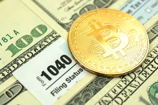 Golden crypto coin and time to pay taxes concept finance background, close-up photo