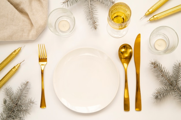 Golden cutlery and copy space plate