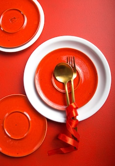 Golden cutlery on plate