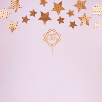 Golden decorations for birthday party with copy space