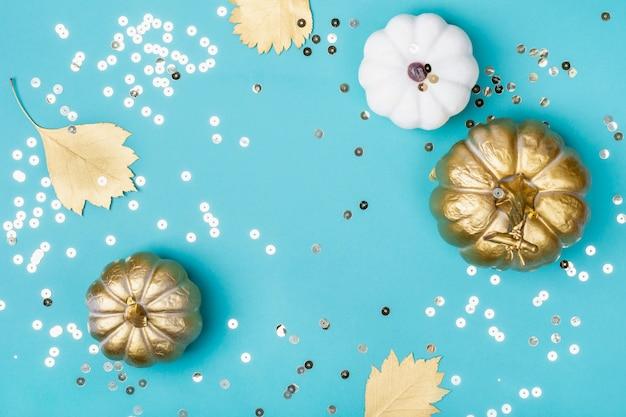 Golden decorative pumpkins and sparkles frame