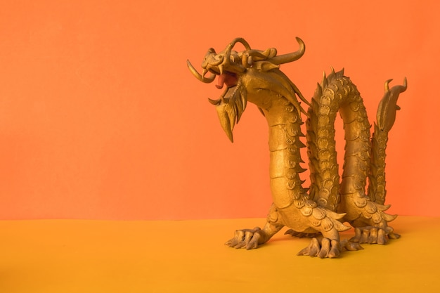 Golden dragon statue is a symbol of wealth and power in the faith of chinese