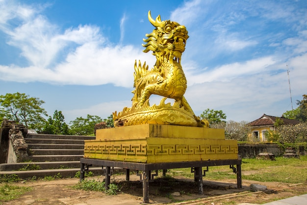 Golden dragon statue located inside imperial royal palace, forbidden city in hue, vietnam