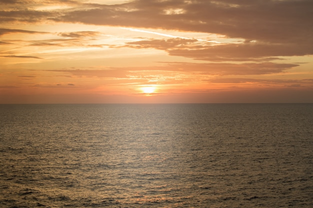 Golden dramatic sunset over the mediterranean sea, beautiful natural background, tranquility and harmony in nature,  travel and sea cruises