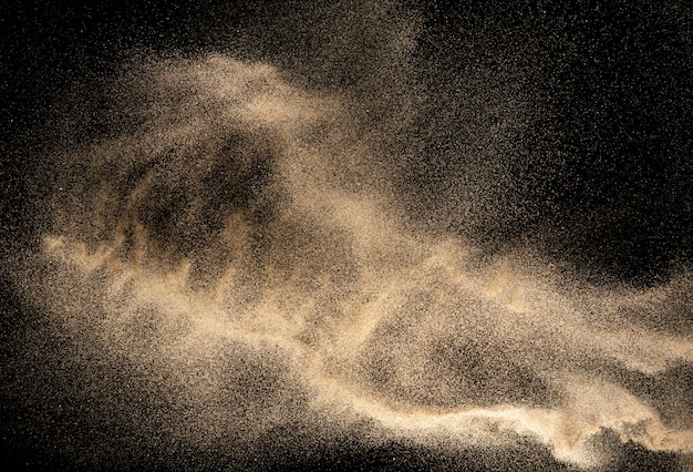 Golden dust explosion on black background