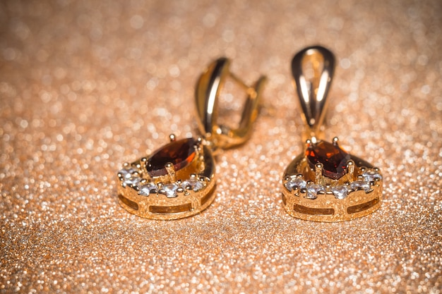 Golden earrings with garnet