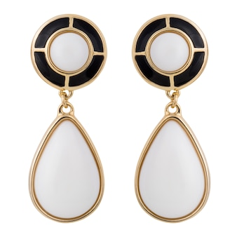 Golden earrings with gemstone isolated on white surface