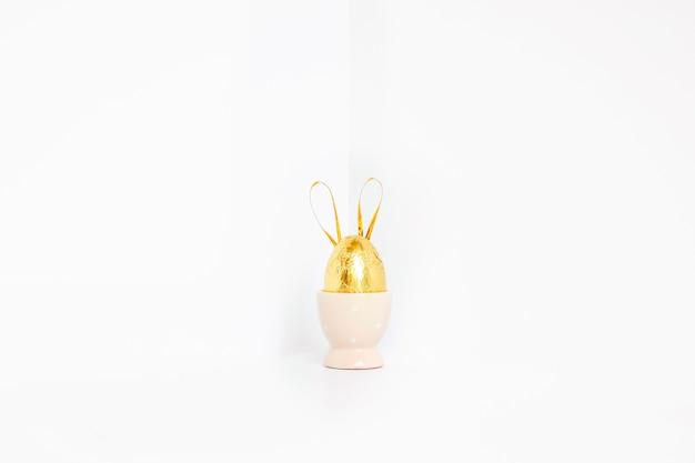 Золотое пасхальное яйцо с ушами кролика
