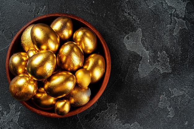 Golden easter eggs on a bowl