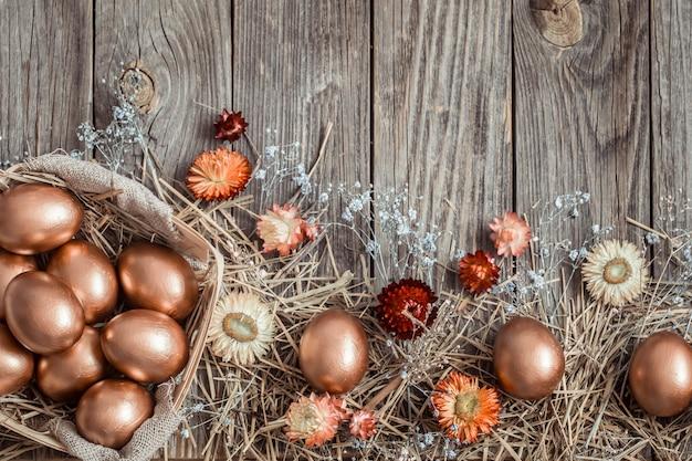 Golden easter eggs on wooden surface